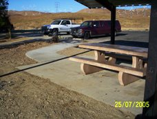 A shaded new picnic table is among several that are accessible.