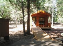 New accessible cabins in the Main Campgound are shaded and inviting.