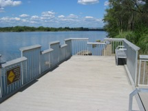 A fishing pier with lowered railing areas for wheelchair fishing is one of many accessible features at the Nimbus Flats area.